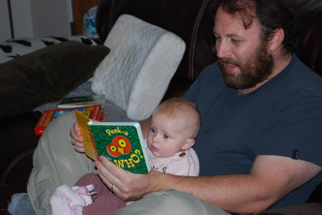 daddy reads to ellie
