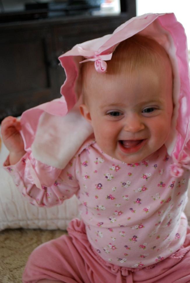 baby plays peekaboo